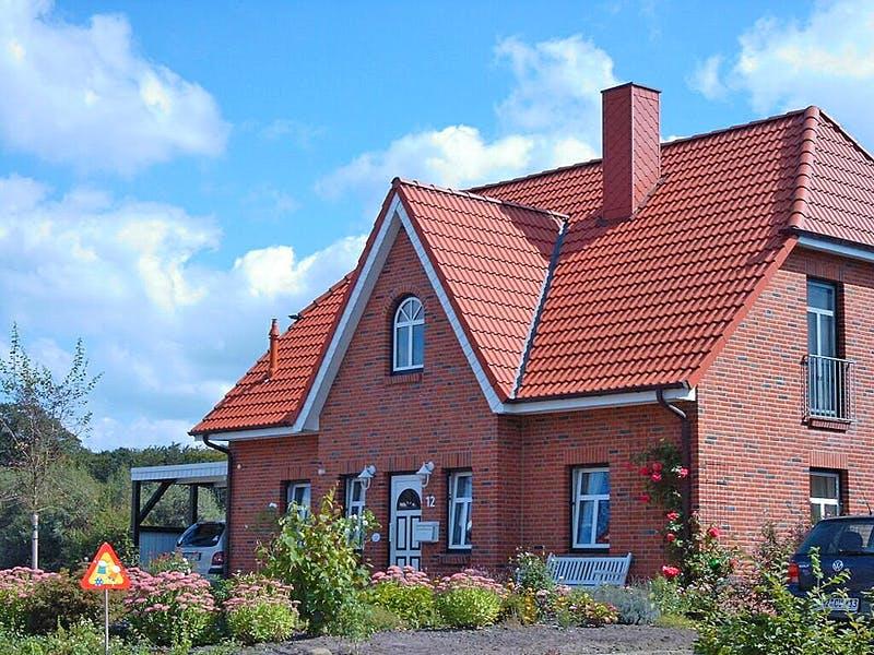 Einfamilienhaus mit Backsteinen von AThoden Bau