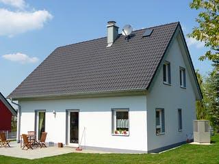 ICON 3+ mit Satteldach von Dennert Massivhaus Außenansicht 1