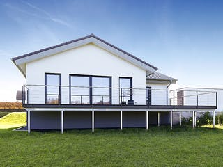 ICON Winkelbungalow von Dennert Massivhaus Außenansicht 1