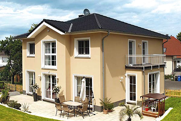 Gelbe Stadtvilla mit Sprossenfenster von Dümer Haus