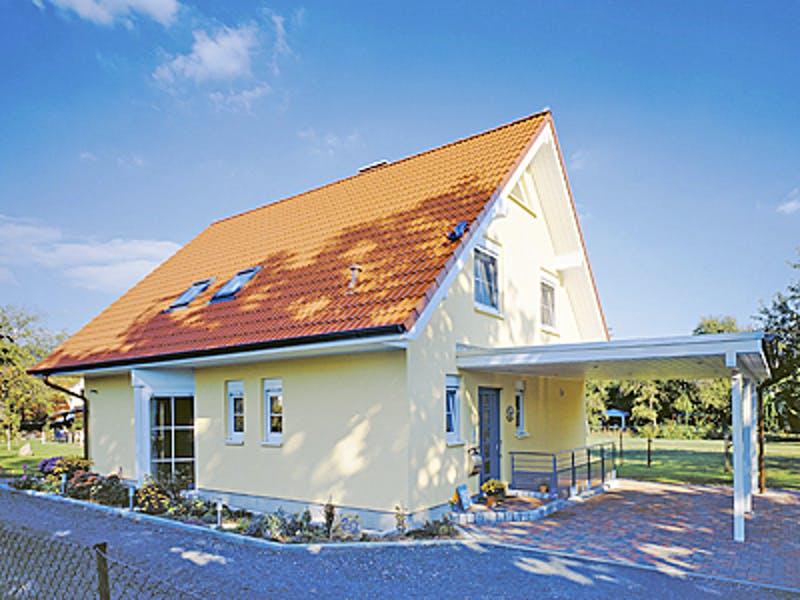Hellgelbes Haus mit rotem Satteldach von Dümer Haus