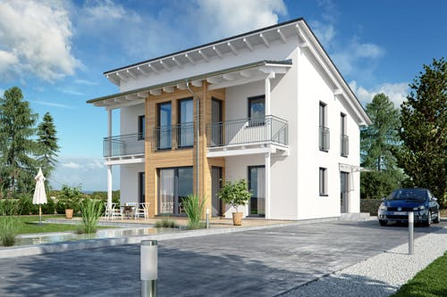 Pultdachhaus bei dem das Dach als Balkonüberdachung dient