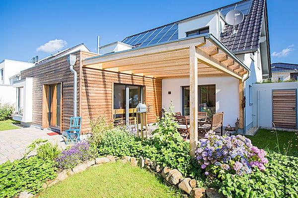 Einfamilienhaus mit Wintergarten von Hausbau Heggemann