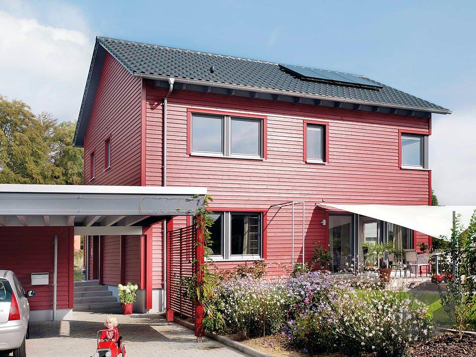 E 20-148.6 - Haus in rot von SchwörerHaus Außenansicht