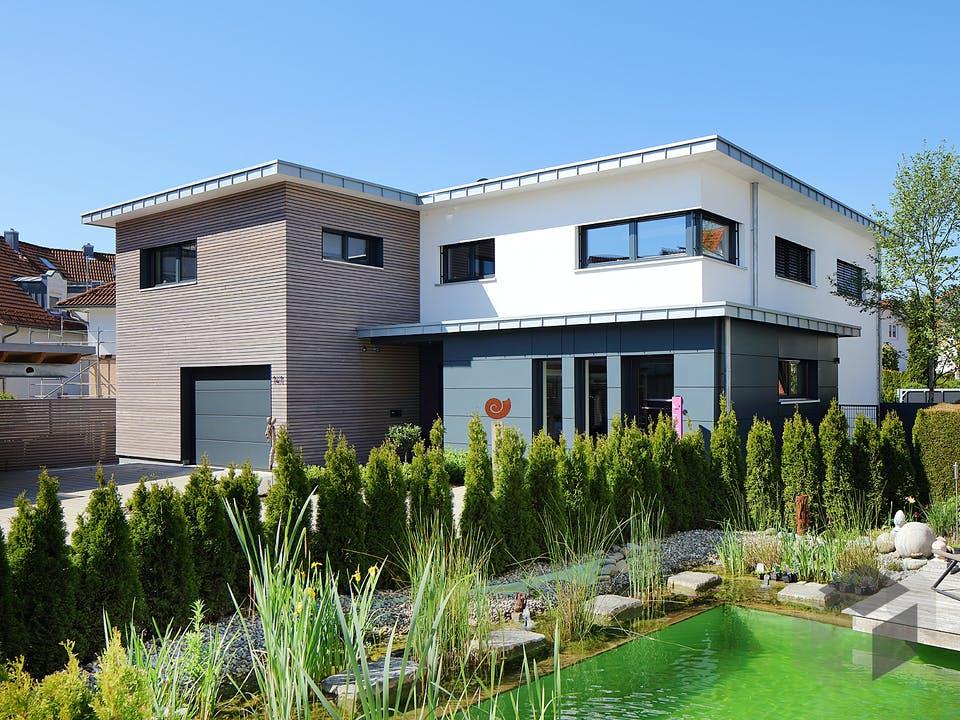 Haus mit Gewerbe WPBW von Weizenegger Außenansicht
